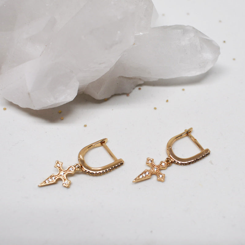 Hailey Jane gold cross and zircon stone earrings.