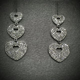 "POIRAY of Paris ""Hearts"" Diamond dangling Earrings"
