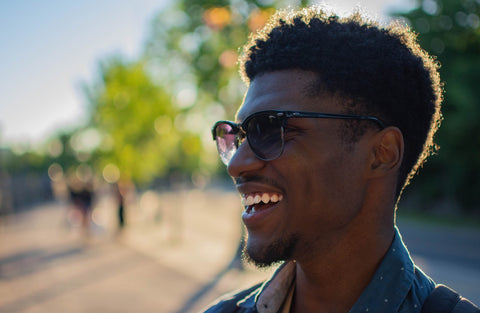 smiling man wearing sunglasses