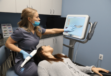 Female patient getting her teeth scanned for clear aligner treatment