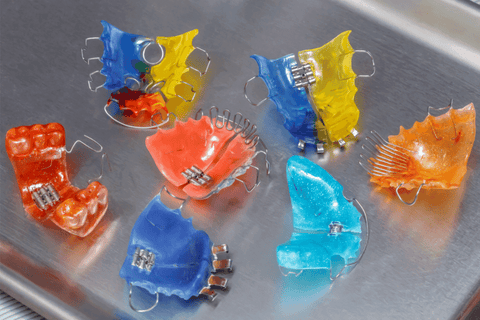 Hawley retainers colorful on metal tray