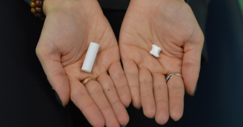 Hands showing the difference between Invisalign chewies and Movemints clear aligner mints