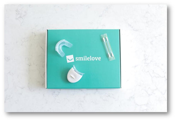 SmileLove at home teeth aligner box comes with a whitening kit for clear braces