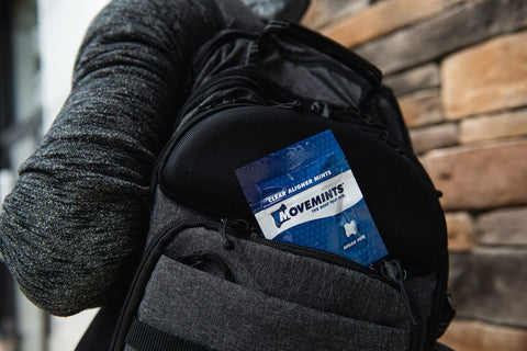 backpack with package of movemints on the go dental care