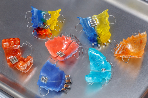 colorful retainers on metallic tray
