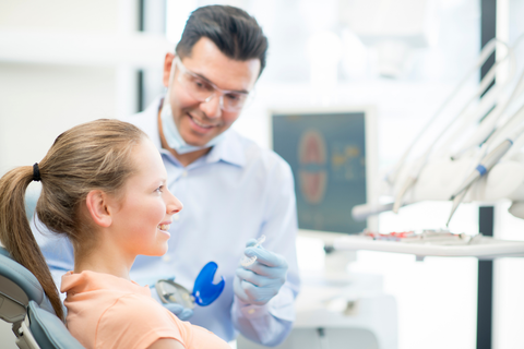 dentist and patient with invisalign trays