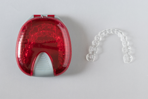 invisible aligner and red case