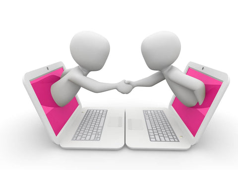 two animations shaking hands out of laptop pink screens