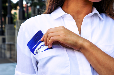 woman in white shirt holding pack of movemints