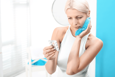 woman using ice pack for tooth pain