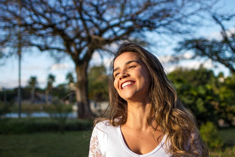 young woman outside smiling bright happy carefree
