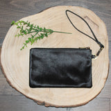 Hannah: Small Leather and Cowhide Pouch Clutch with wrist strap