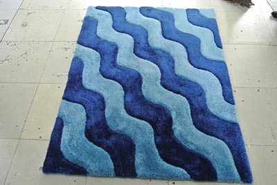Curling Two Shades of Blue Rug