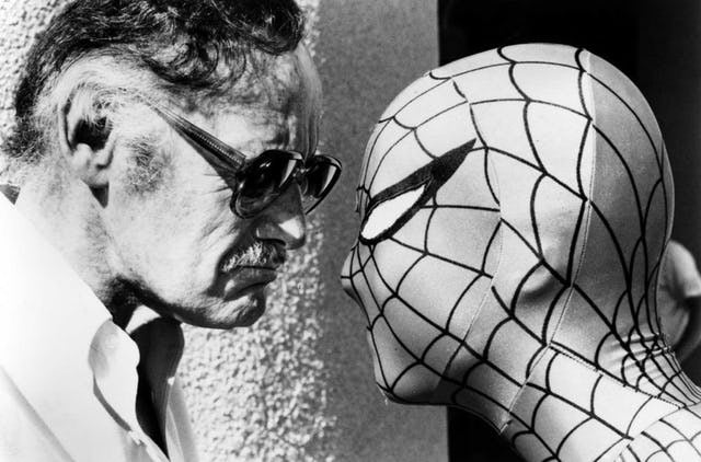 Stan Lee and Spider-Man (Chris Sanders) stare each other down
