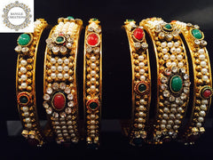 Gold plated bangle set of 6