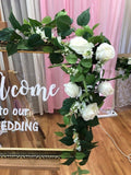 Welcome sign with white roses