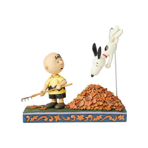 PRE-ORDER: Enesco: Peanuts Charlie Brown and Snoopy in Leaves Jumping into Fall by Jim Shore