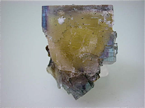 Fluorite with Barite Inclusions, Rosiclare Level Minerva #1 Mine, Ozark-Mahoning Company, Cave-in-Rock District, Southern Illinois, Mined c. 1992-1993, Tolonen Collection, Miniature 3.2 x 3.8 x 5.2 cm $350. Online 1/15 SOLD
