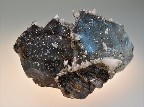 Pyrite and Calcite on Fluorite, Bethel Level West Green Mine, Ozark-Mahoning Company, Cave-in-Rock District, Southern Illinois, Mined circa 1960s, Wayne Fowler Collection, Medium Cabinet 6.0 x 9.5 x 11.0 cm, $450.  Online 7/25