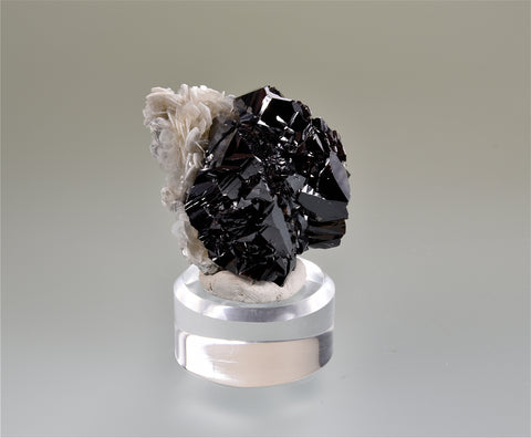Cassiterite on Muscovite, Pingwu, Sichuan Province, China, Mined c. 1999, Megerle Collection, Miniature 3.5 x 3.5 x 4.5 cm, $450. Online 3/9