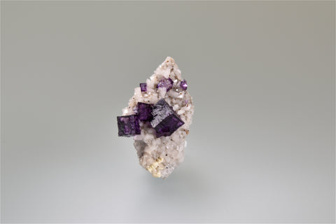 Fluorite on Dolomite, Elmwood Complex, Smith County, Tennessee, Mined c. 1990's, Ralph Campbell Collection, Miniature 2.0 x 2.0 x 4.0 cm, $35. Online 10/4.