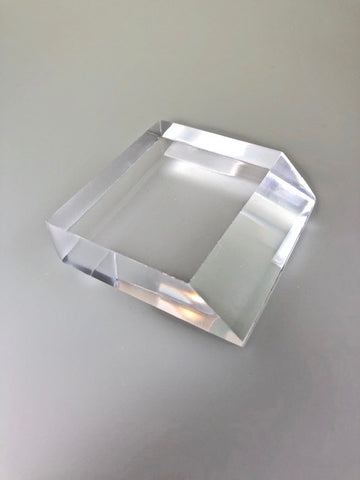Angled Front Face Rectangle Acrylic Base 11/16 inch thick x 2 1/2 inch wide x 2 1/2 deep (bottom face) and 1 7/8 (top face), $10.