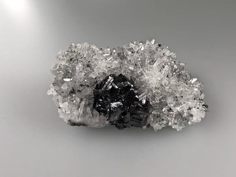 Sphalerite on Quartz, Borieva Mine, Madan District, Bulgaria, Mined c. 2012, Miniature 3.0 x 4.5 x 7.5 cm, $85.  Online January 30.