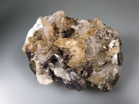 Calcite and Celestite on Fluorite, Sub-Rosiclare Level attr., Minerva #1 Mine, Ozark-Mahoning Company, Cave-in-Rock District, Southern Illinois, Mined c. 1993, Ron Roberts Collection CE-16, Small Cabinet, 5.5 x 7.5 x 10.5 cm, $125.  Online September 14.