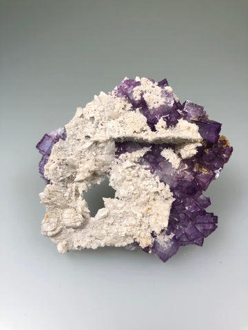 Fluorite with Calcite,  Bethel Level attr., Minerva #1 Mine attr., Minerva Oil Company attr., Cave-in-Rock District, Southern Illinois, Mined c. 1960's, Ron Roberts Collection CF-106, Miniature 1.0 x 5.5 x 5.5 cm, $35.  Online September 14.