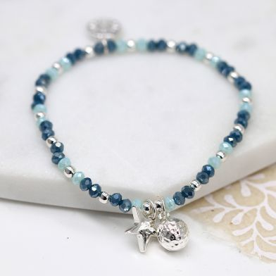 Silver Plated And Blue Bead Bracelet With Star And hammered bead
