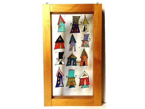 Hand painted in stained glass technique decorative glass window with whimsical houses