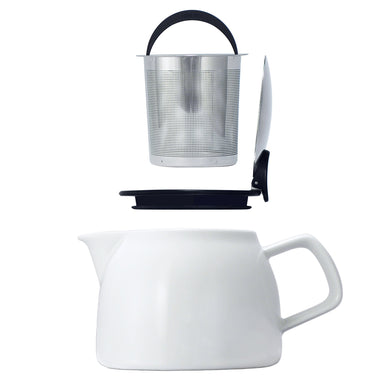 Tealula Silver basket infuser with black handle hovers over square handle and black and silver removable push-on-lid hovers over 16 oz bell-shaped white teapot with square handle