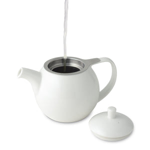 stream of water being poured into a open TeaLula 24 oz Curve sphere white Teapot glossy surface finish and white lid on the side