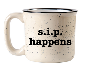 "off white camp mug with black speckles of paint on the surface and black rim circle handle and the words ""s.i.p. happens"" in black font"
