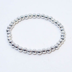 Stretchy Bracelet with 6mm. Round Metal Beads