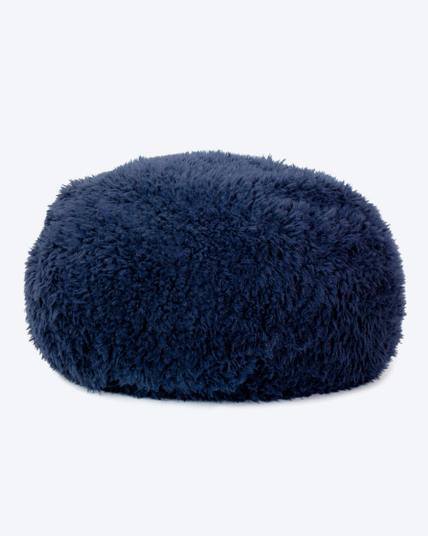 A dog bed is in navy soft material, available in small and large sizes and made out of recycled materials.