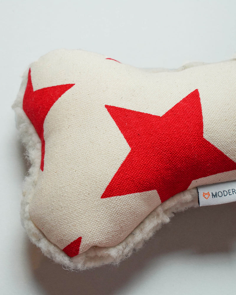 Red star canvas dog toy with a sherpa back and squeaker inside.