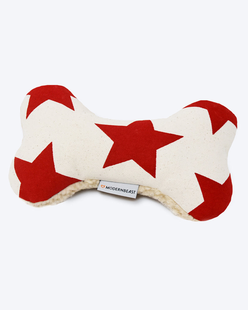 Red star plush canvas dog toy with a sherpa back and squeaker inside.