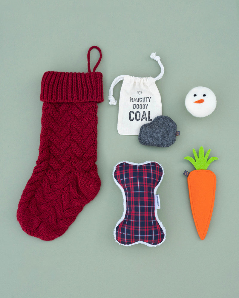 Modernbeast Red Christmas Stocking comes with naughty doggy coal, a snowman beastball, a holiday red plaid zenbone filled with lavender, and a puppy carrot filled with a squeaker.