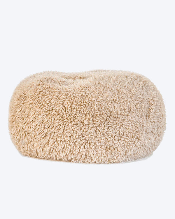 A dog bed is in tan soft material, available in small and large sizes and made out of recycled materials.