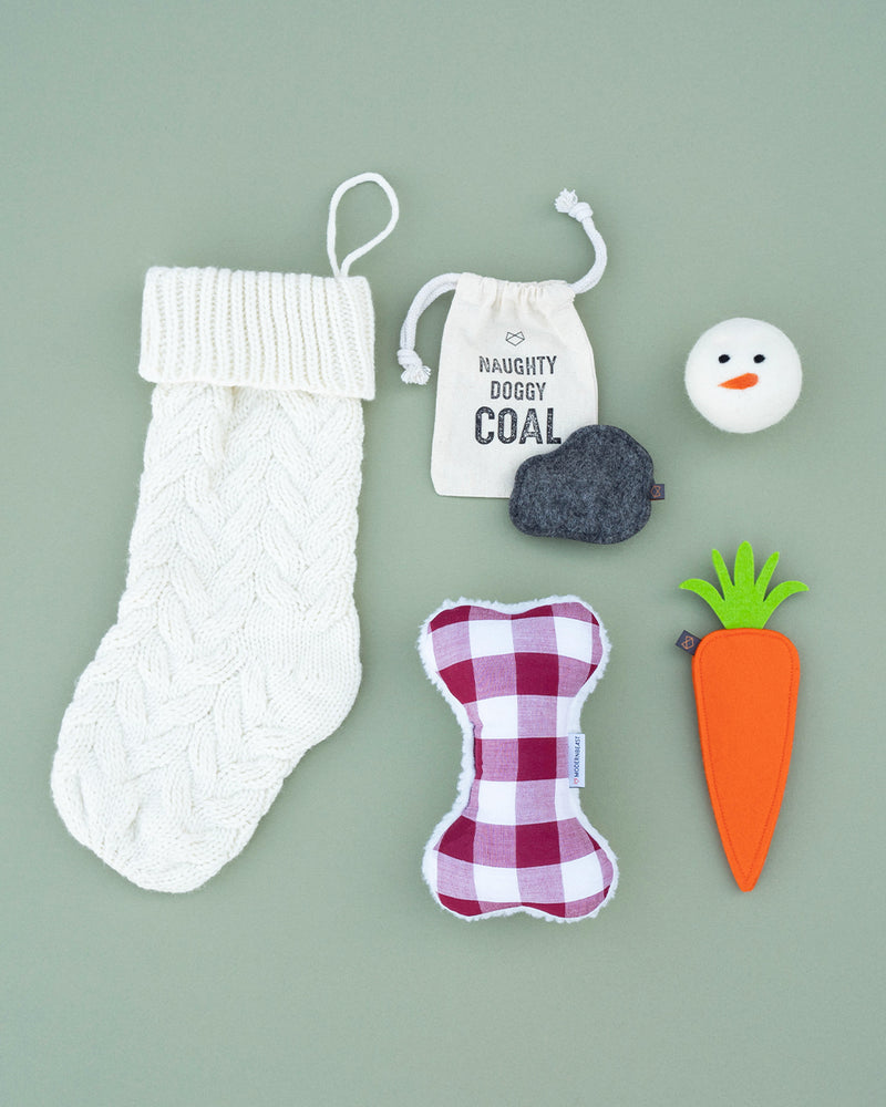 Modernbeast Ivory Christmas Stocking comes with naughty doggy coal, a snowman beastball, a berry gingham zenbone filled with lavender, and a puppy carrot filled with a squeaker.