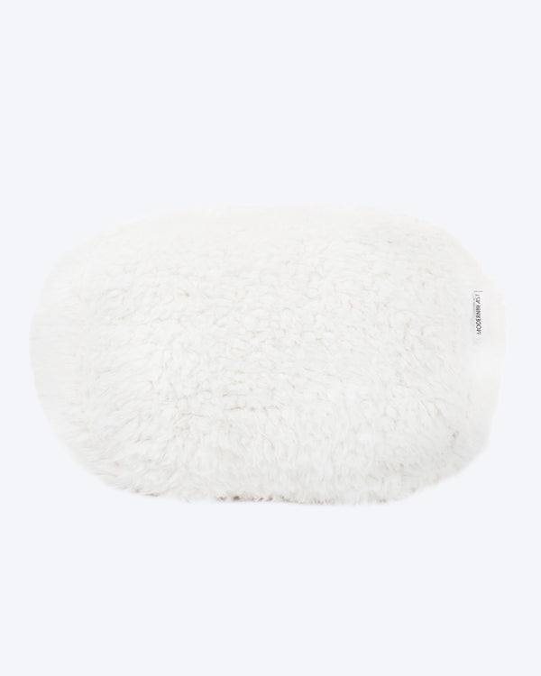 A dog bed is in white soft material, available in small and large sizes and made out of recycled materials.