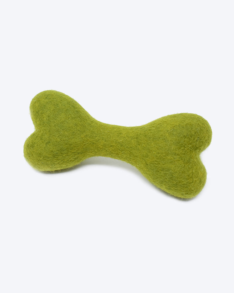 DOG BONE MADE OF 100% ORGANIC WOOL FELT DENSELY PACKED. ECO FRIENDLY. DURABLE. SMALL AND LARGE. GREEN.