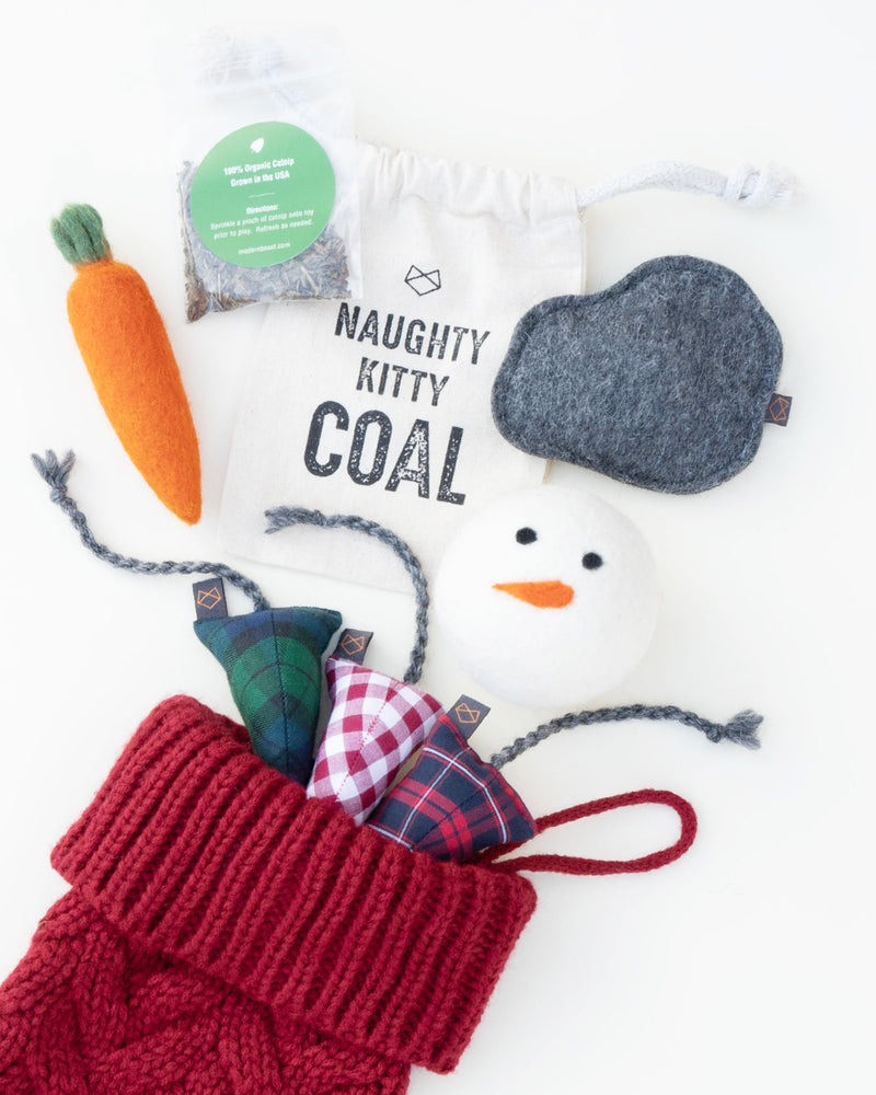 Modernbeast red Christmas Stocking comes with naughty kitty coal, a snowman beastball, a kitty carrot, a bag of organic catnip, and three holiday mice filled with catnip.