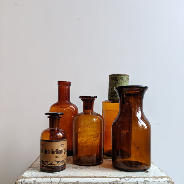 Collection of five vintage amber bottles