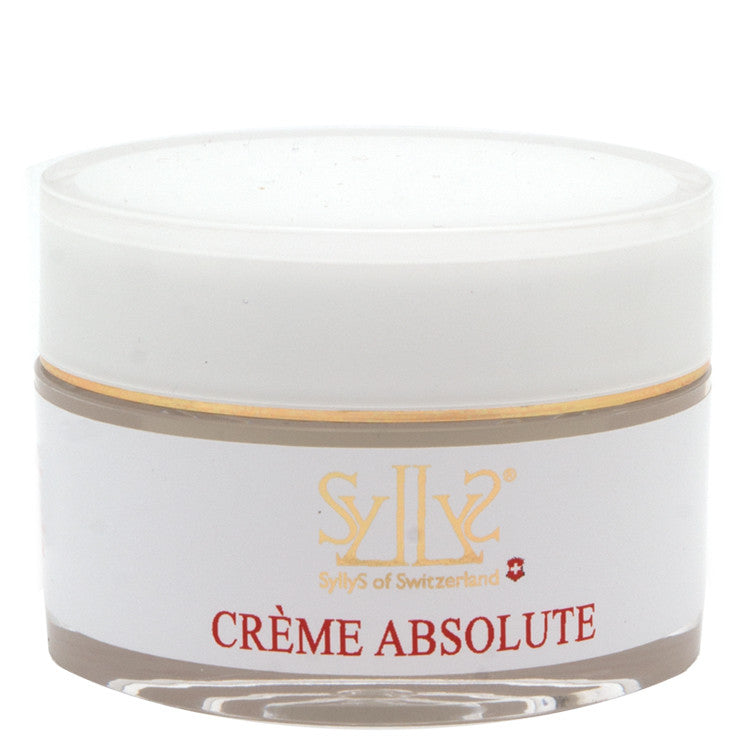 "An all in one moisturizer sealed in a white acrylic jar, and a gold rim on the lid.  The logo Syllys of Switzerland is printed in gold along with the title ""Creme Abosolute"" printed in red below the logo."