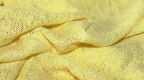 Coupon tissu jersey maille flammé polyester uni jaune soufre