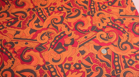 Coupon tissu jersey viscose fond orange à motif vintage