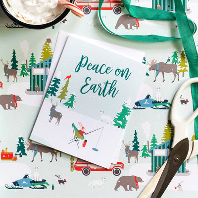 Christmas card with elk, rabbit, ice fishing in the winter. Peace on Earth. REVEL & Co.