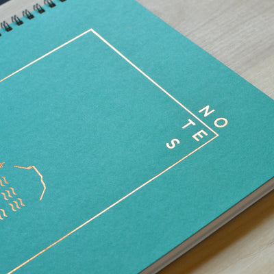 Green notebook with copper foil design. Gift for artist by Revel Paper for the modern desk